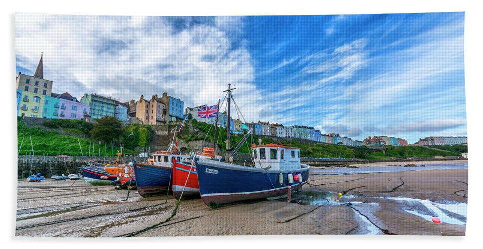 Wales; Uk; Britain; Ocean; Atlantic Hand Towel featuring the digital art Red And Blue Fishing Trawler In Low Tide by Tsafreer Bernstein
