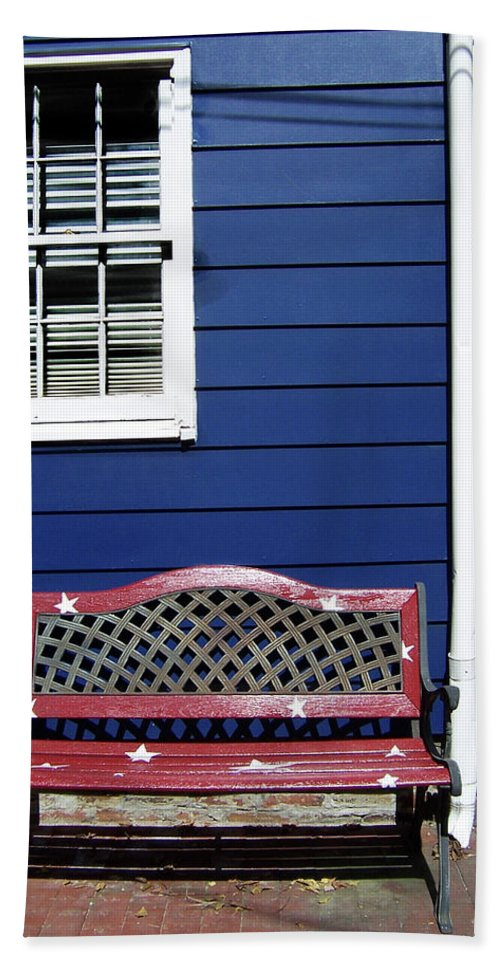 Hand Towel featuring the photograph Red Bench Blue House by Iris Posner