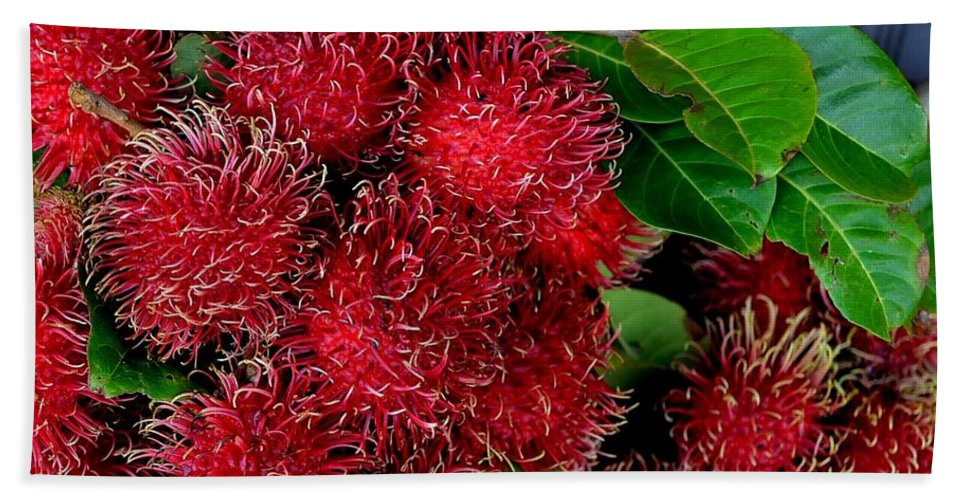 Rambutan Hand Towel featuring the photograph Red Rambutan And Green Leaves by Mary Deal