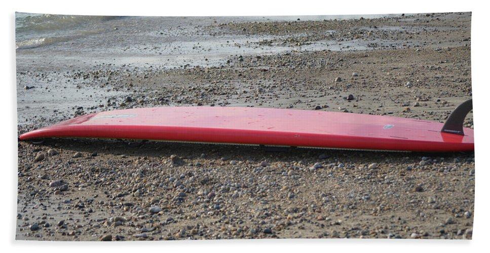 Surfboard Bath Sheet featuring the photograph Red Surf Board On A Rocky Beach by DejaVu Designs
