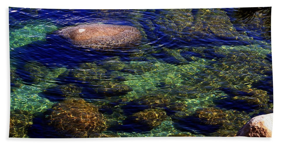 Water Hand Towel featuring the photograph Rocks Ripples And Reflections by Lynn Bawden