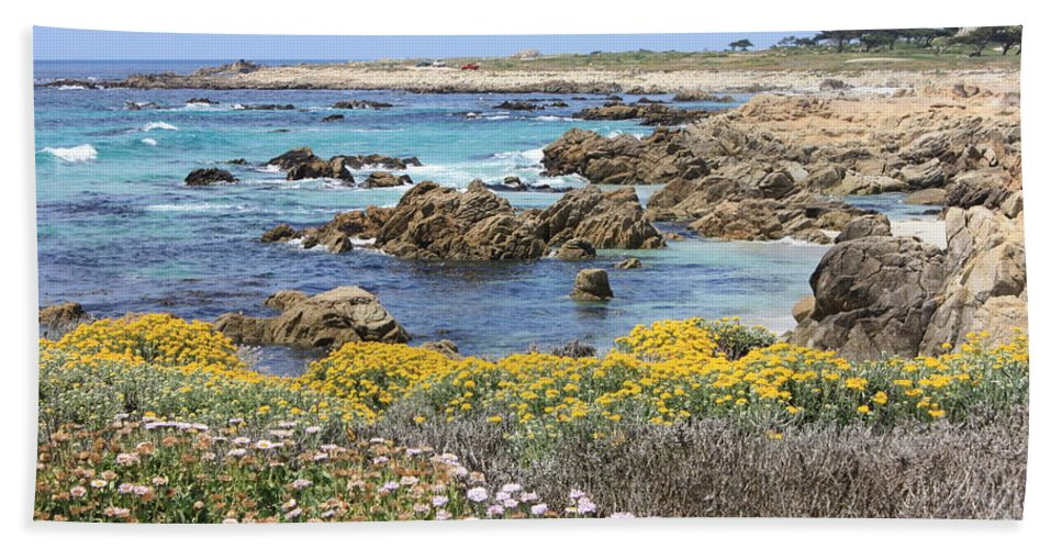 Ocean Bath Towel featuring the photograph Rocky Surf With Wildflowers by Carol Groenen