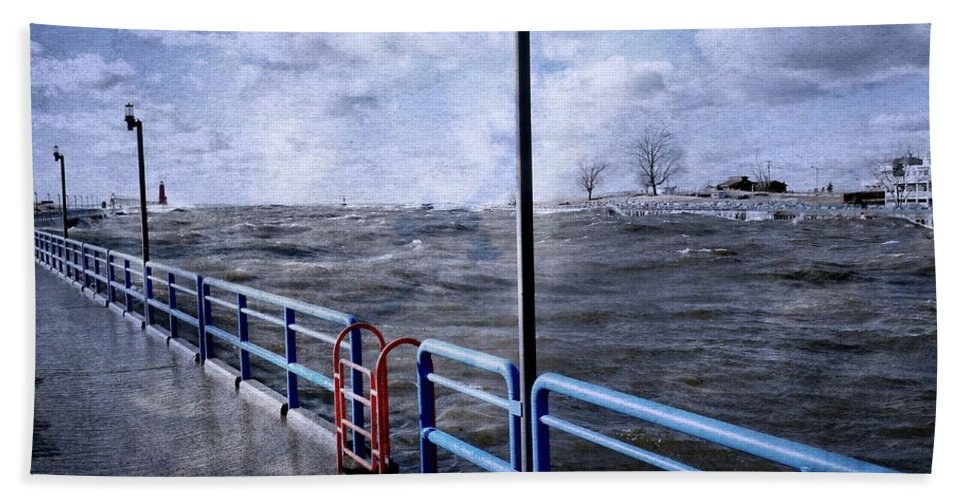 Lighthouse Bath Sheet featuring the photograph Rolling Waves In Winter At Grand Haven by Michelle Calkins