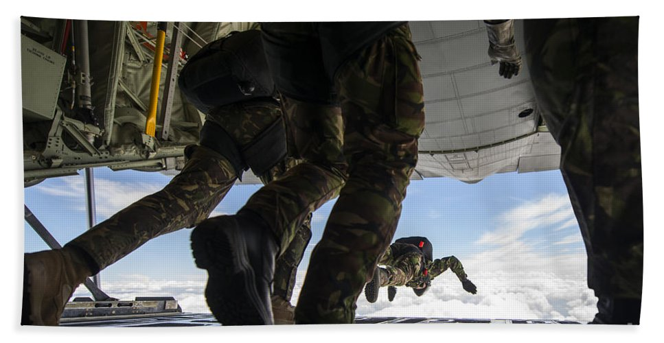 Horizontal Bath Sheet featuring the photograph Romanian Paratroopers Perform A Halo by Stocktrek Images
