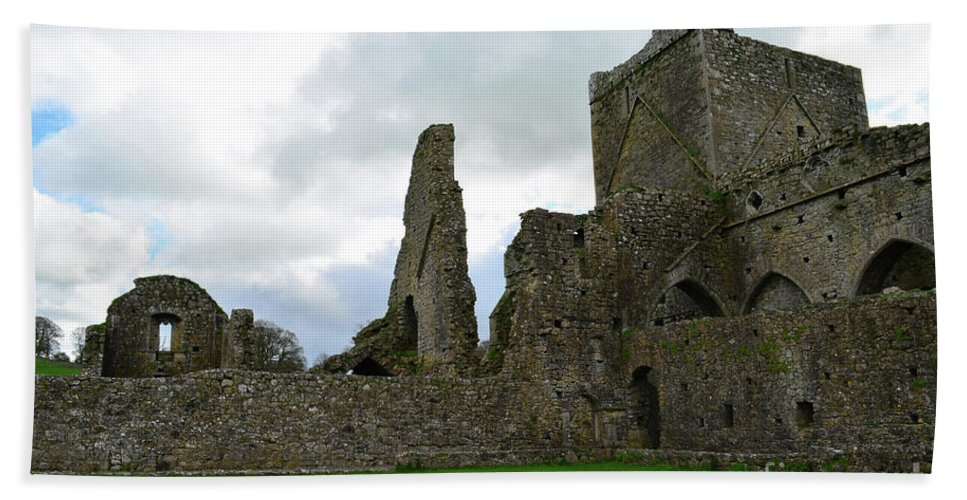 Hore Abbey Hand Towel featuring the photograph Ruins Of Old Stone Abbey In Ireland by DejaVu Designs