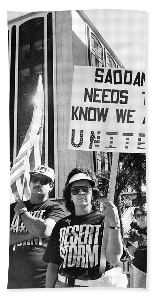 Saddam Needs To Know Pro Desert Storm Rally Tucson Arizona 1991 Bath Sheet featuring the photograph Saddam Needs To Know Pro Desert Storm Rally Tucson Arizona 1991 by David Lee Guss