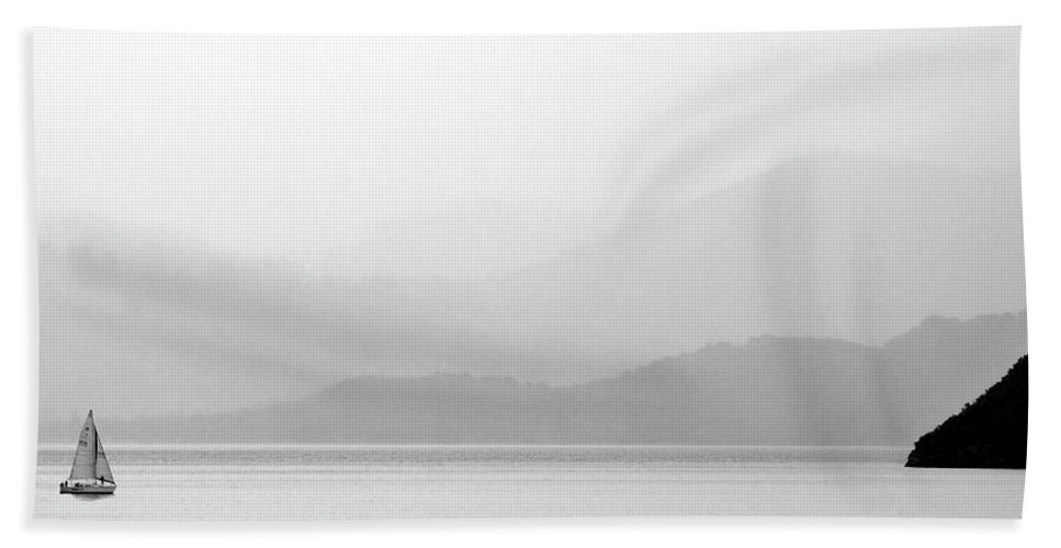 Misty Hand Towel featuring the digital art Sailboat On New Zealands Cook Strait by Mark Duffy