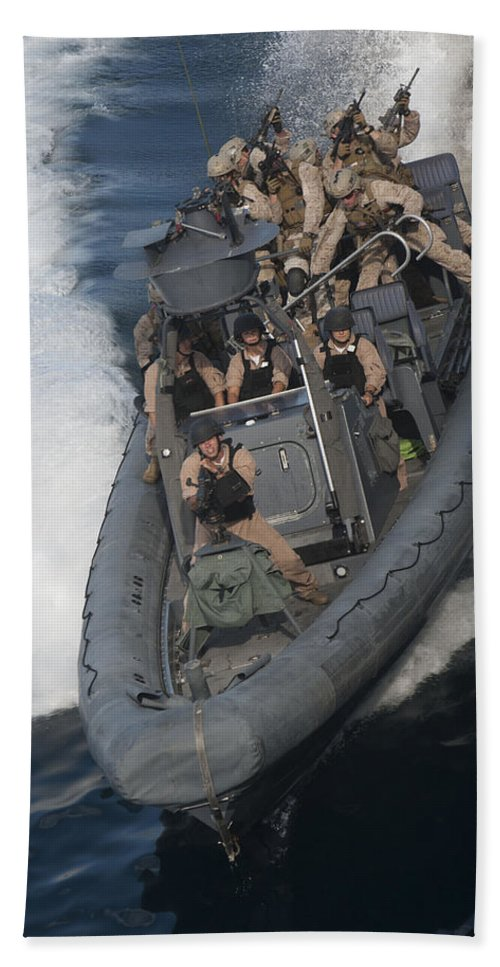 Uss New Orleans Hand Towel featuring the photograph Sailors Operate A Rigid-hull Inflatable by Stocktrek Images