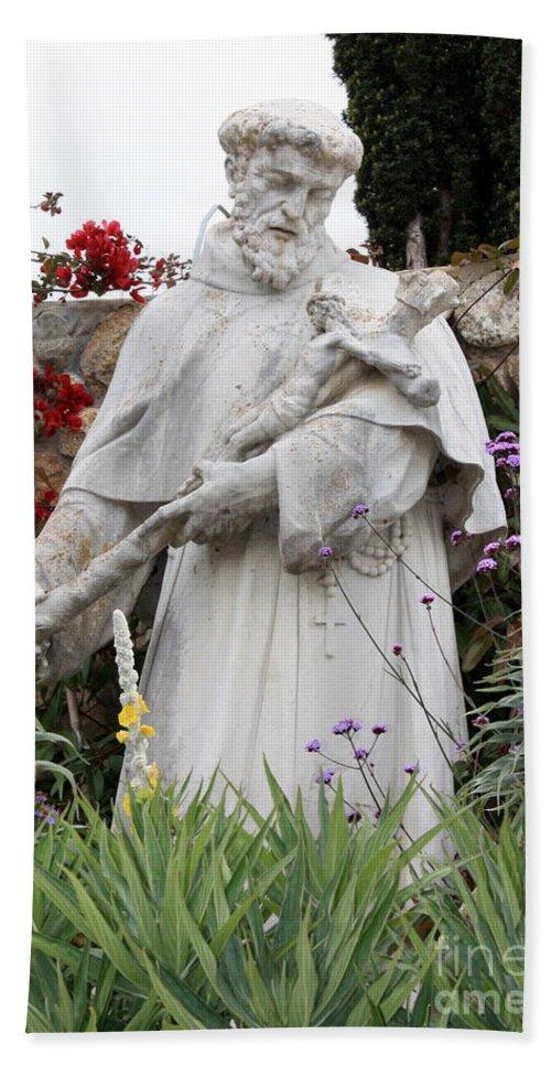 Saint Francis Bath Sheet featuring the photograph Saint Francis Statue In Carmel Mission Garden by Carol Groenen