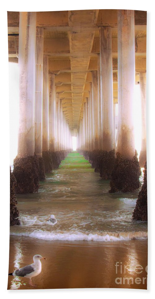 Seagull Under The Pier Ocean Beach Shoreline Waves Fine Art Photography Prints Bath Sheet featuring the photograph Seagull Under The Pier by Jerry Cowart