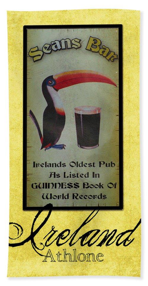 Irish Hand Towel featuring the photograph Seans Bar Guinness Pub Sign Athlone Ireland by Teresa Mucha