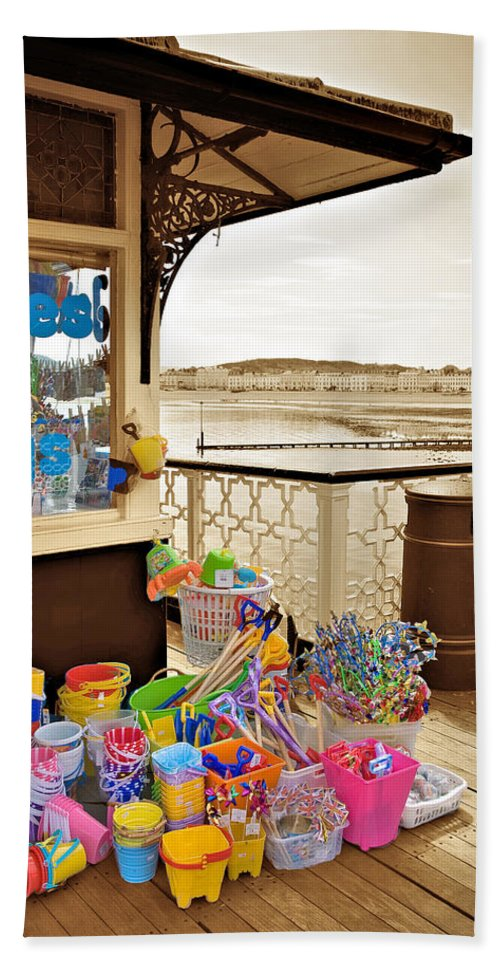 Seaside Bath Towel featuring the photograph Seaside Buckets And Spades For Sale On Llandudno Pier by Mal Bray