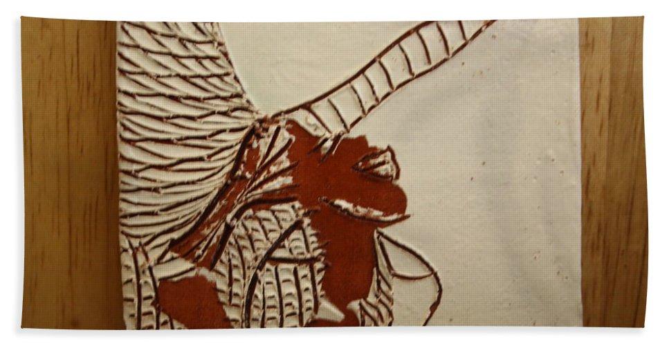 Jesus Hand Towel featuring the ceramic art Selina - Tile by Gloria Ssali