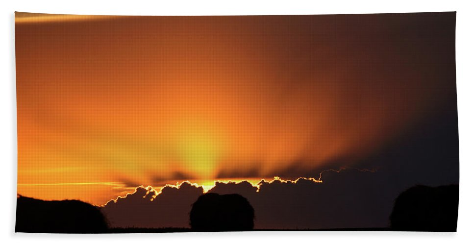 Sun Hand Towel featuring the digital art Setting Sun Peaking Out From Storm Clouds In Saskatchewan by Mark Duffy