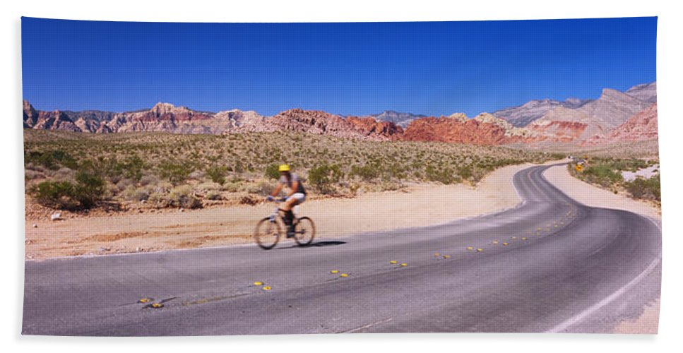 Photography Bath Sheet featuring the photograph Side Profile Of A Person Cycling by Panoramic Images