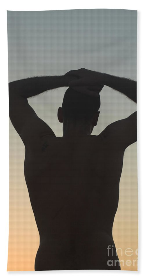 Delight Hand Towel featuring the photograph Silhouette Of A Man At Sunset by Ilan Rosen