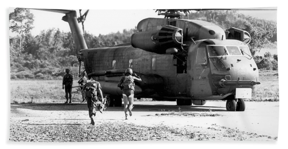 Pararescuemen Hand Towel featuring the photograph Soldiers Run To A Hh-53c Helicopter by Stocktrek Images