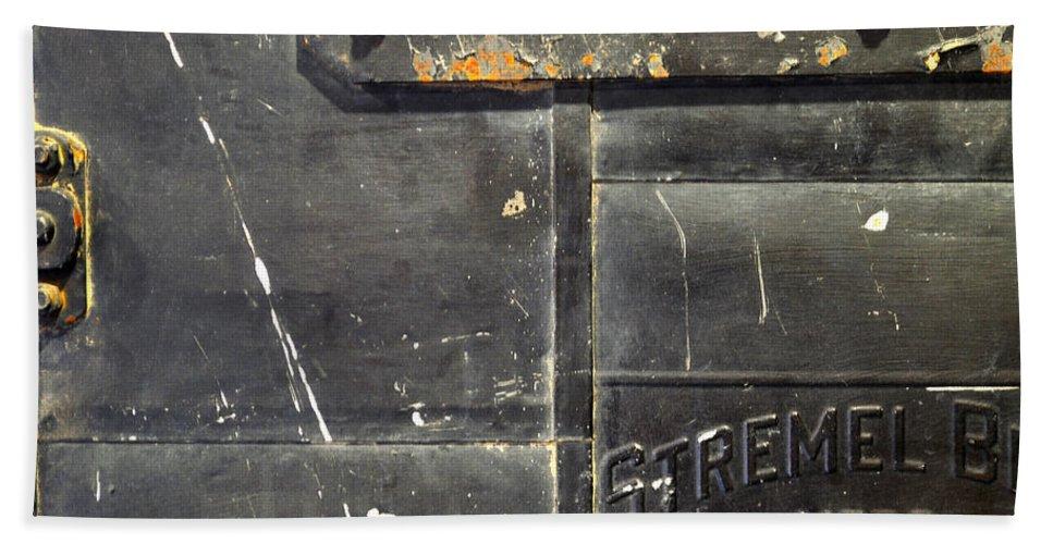 Firedoor Bath Sheet featuring the photograph Stremel Bros. Firedoor by Tim Nyberg