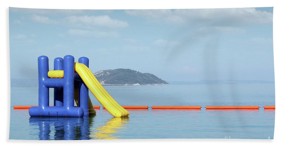 Sithonia Hand Towel featuring the photograph Summer Vacation Scene With Water Slide by Goce Risteski