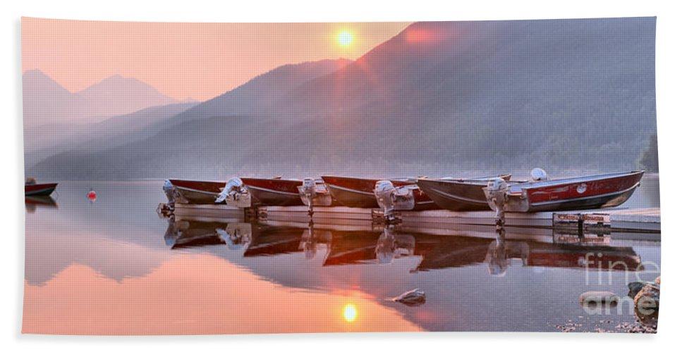 Lake Mcdonald Hand Towel featuring the photograph Sun Through Smoke At Mcdonald by Adam Jewell