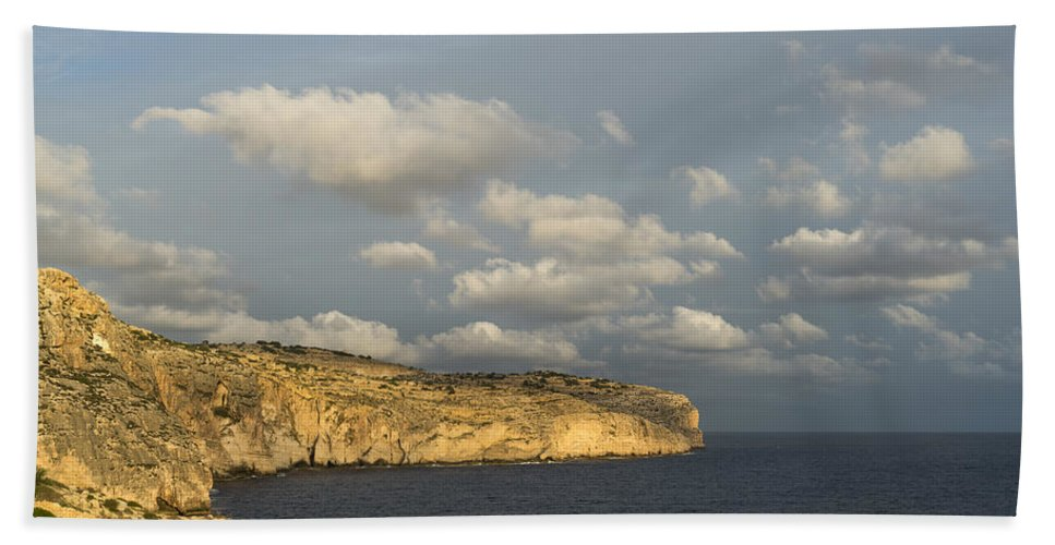 Georgia Mizuleva Bath Sheet featuring the photograph Sunlit Limestone Cliffs In Malta by Georgia Mizuleva