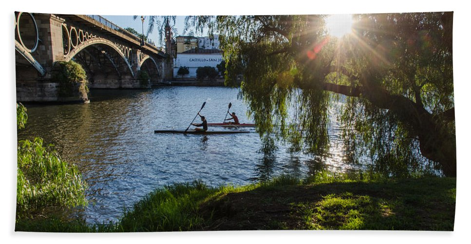 Seville Hand Towel featuring the photograph Sunset On The River - Seville by Andrea Mazzocchetti
