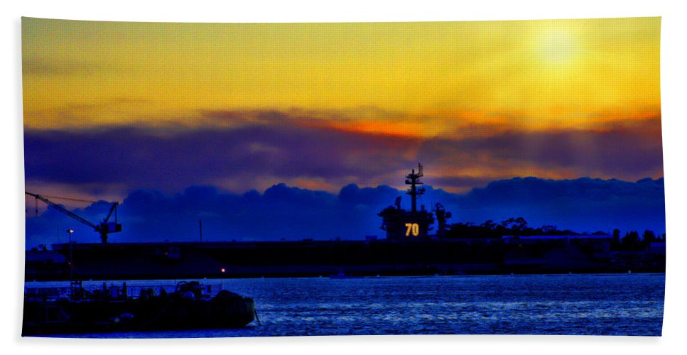 Uss Carl Vinson (cvn-70) Bath Sheet featuring the photograph Sunset Over The Carl Vinson by Tommy Anderson