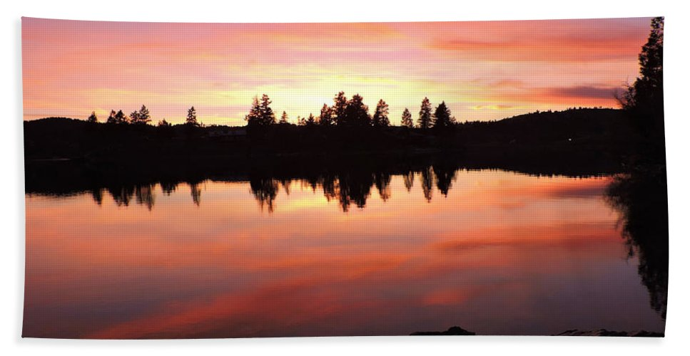 Mountains Hand Towel featuring the photograph Sunset Reflections by Eric Fellegy