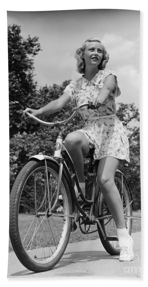 1930s Bath Sheet featuring the photograph Teeng Girl Riding Bike On Sidewalk by H. Armstrong Roberts/ClassicStock
