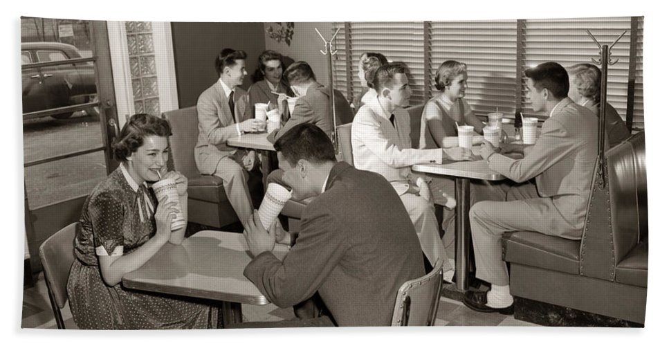 1950s Bath Sheet featuring the photograph Teens At A Diner, C. 1950s by H. Armstrong Roberts/ClassicStock