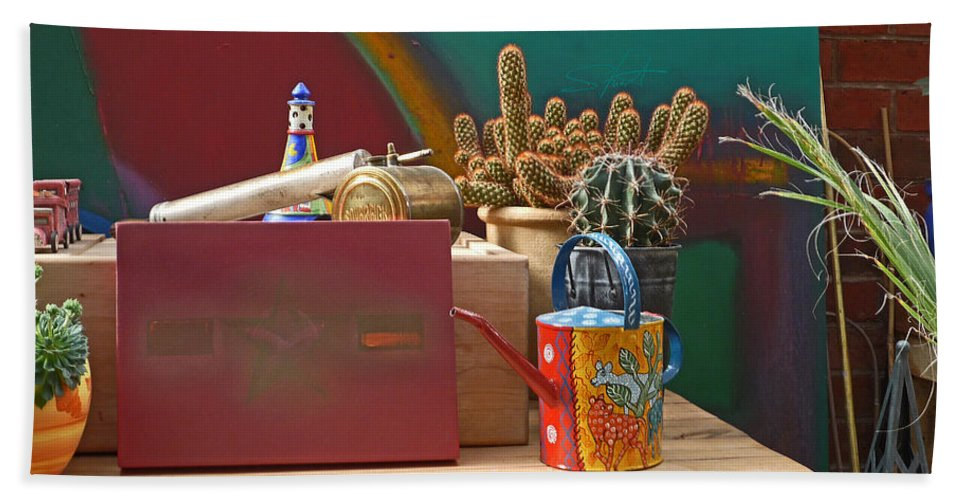 Garden Room Hand Towel featuring the photograph The African Watering Can by Charles Stuart