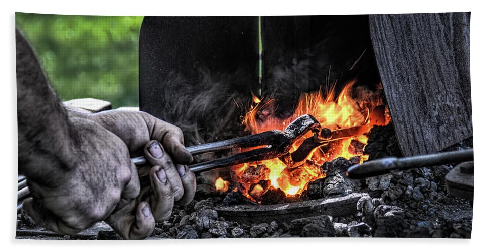 Blacksmith Hands Bath Sheet featuring the photograph The Blacksmith by Wes Iversen