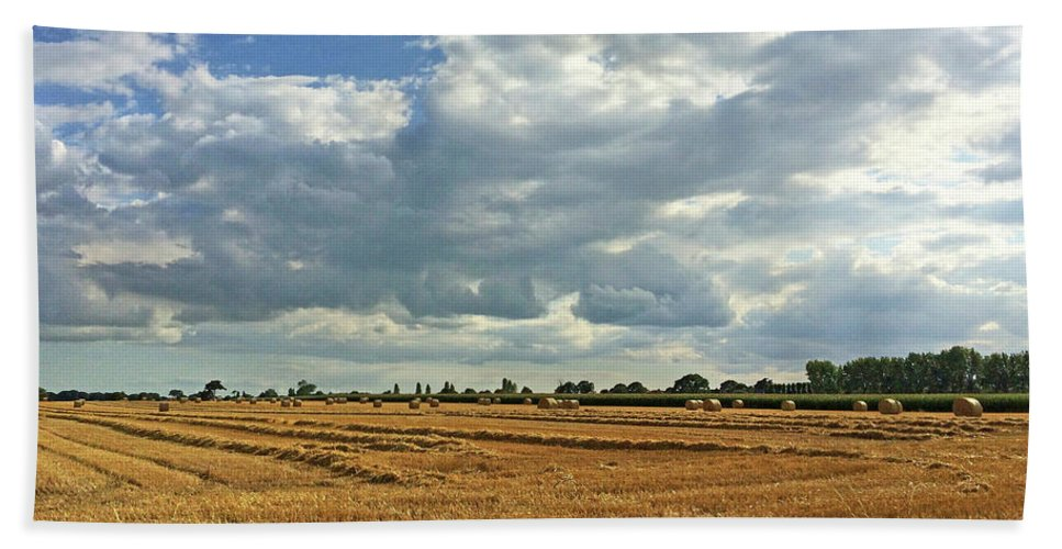 Landscape Corn Field Clouds Sky Straw Hay Tree England Summer Autumn Uk View Hand Towel featuring the photograph The Cornfield by John R Moore