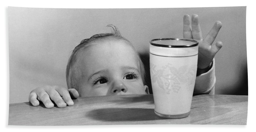 1950s Bath Sheet featuring the photograph Toddler Reaching For Glass Of Milk by O. Johnson/ClassicStock
