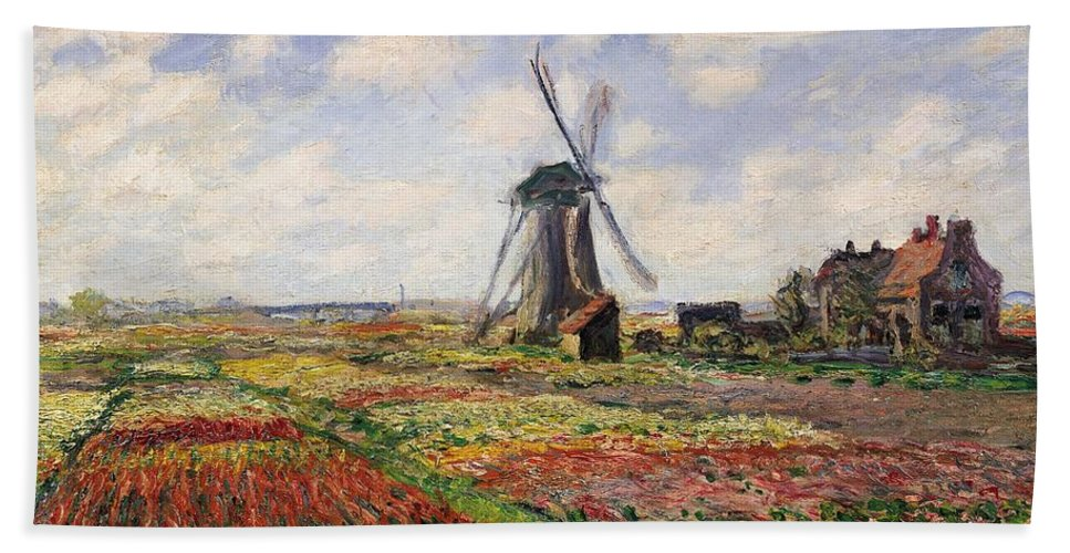 Claude Monet Hand Towel featuring the painting Tulip Fields With The Rijnsburg Windmill by Claude Monet