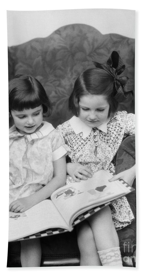 1920s Bath Sheet featuring the photograph Two Girls Reading A Book, C.1920-30s by H. Armstrong Roberts/ClassicStock