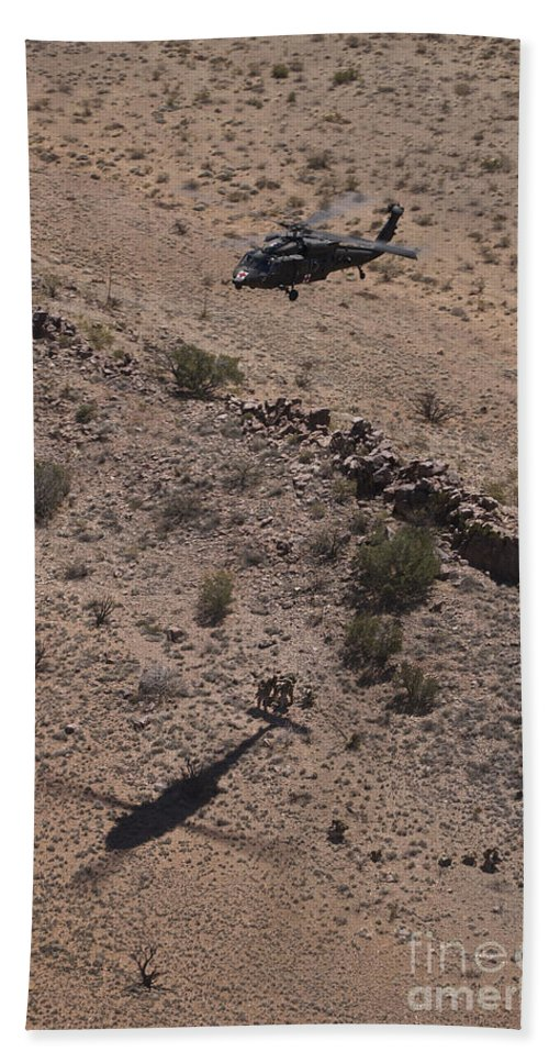Exercise Angel Thunder Bath Sheet featuring the photograph Uh-60 Black Hawk Hovers Above U.s by Terry Moore