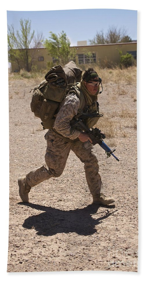 Exercise Angel Thunder Bath Sheet featuring the photograph U.s. Marine Runs To The Uh-60 Black by Terry Moore