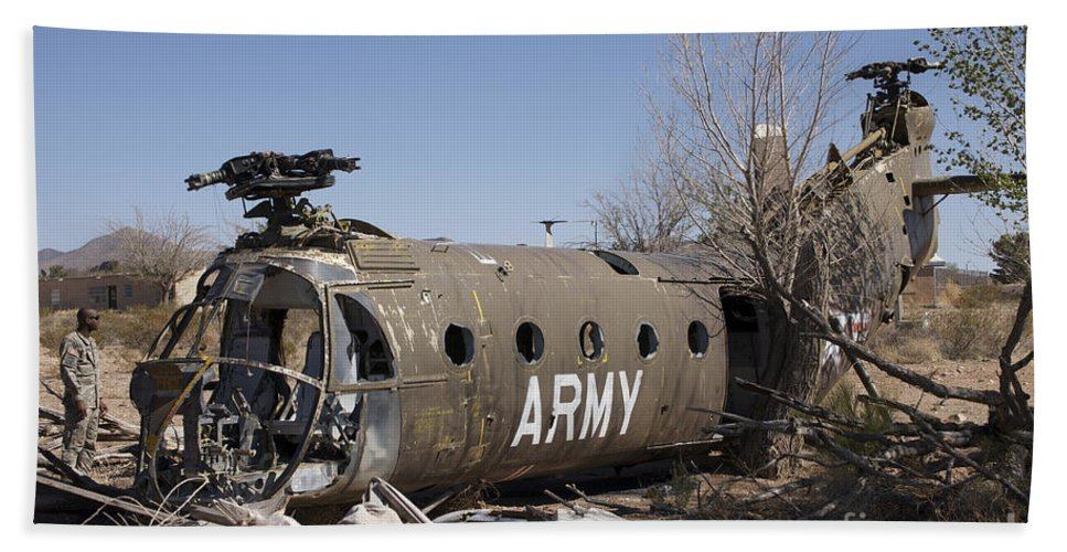 Exercise Angel Thunder Bath Sheet featuring the photograph U.s. Soldier Inspects The Wreckage by Terry Moore