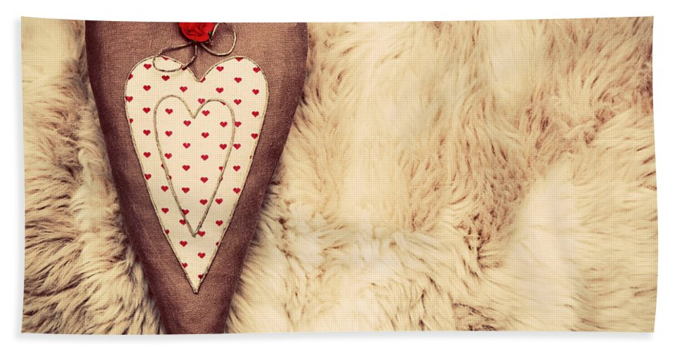 Heart Hand Towel featuring the photograph Vintage Handmade Plush Heart Pillow On The Soft Blanket by Michal Bednarek