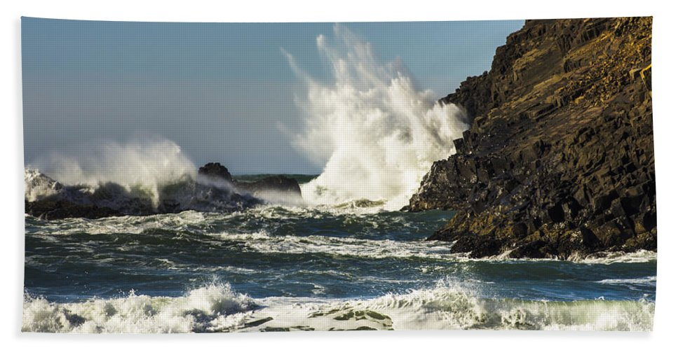 Cannon Beach Hand Towel featuring the photograph Water Meets Rock by John Trax