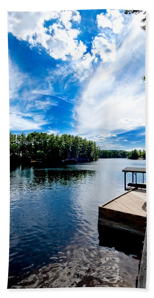 Water Hand Towel featuring the photograph Water Mirrors Sky by Greg Fortier