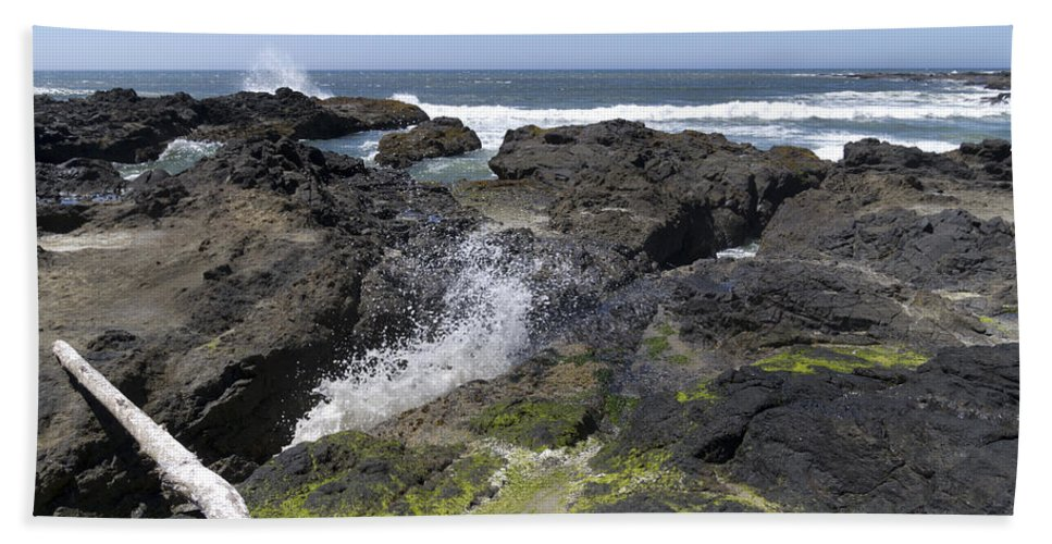 Devils Punch Bowl Hand Towel featuring the photograph Waves Crash Ashore On A Lava Bed by John Trax