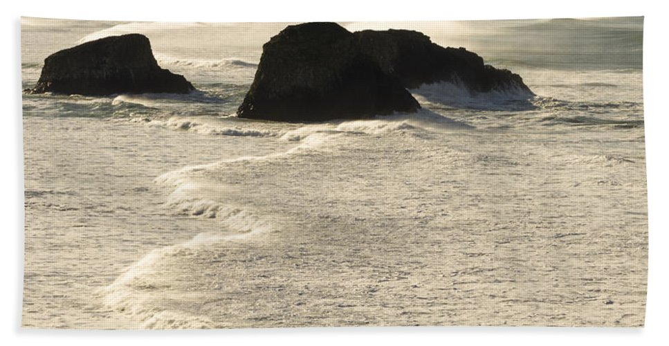 Cannon Beach Hand Towel featuring the photograph Waves Roll Ashore On The Oregon Coast by John Trax