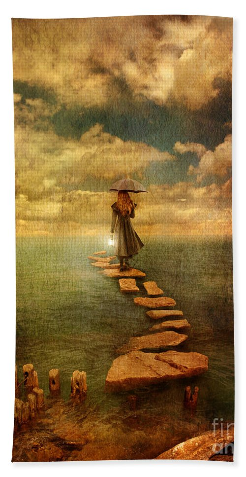 Woman Bath Sheet featuring the photograph Woman Crossing The Sea On Stepping Stones by Jill Battaglia