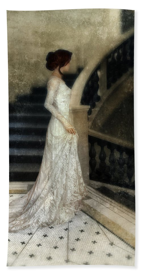 Woman Bath Sheet featuring the photograph Woman In Lace Gown On Staircase by Jill Battaglia