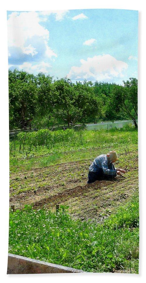 Woman Bath Sheet featuring the photograph Woman Planting Garden Near Barn by Susan Savad