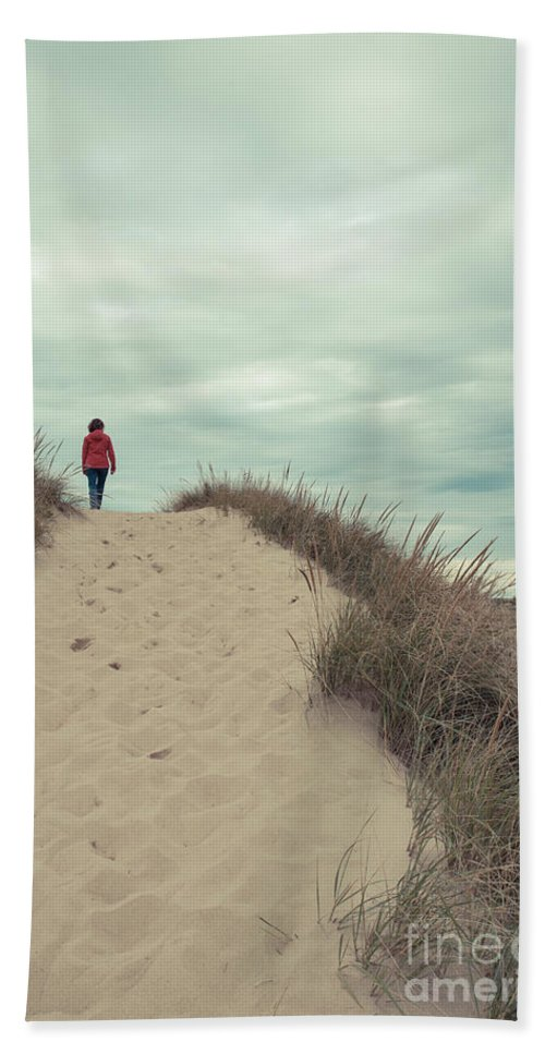 Cape Cod Hand Towel featuring the photograph Woman Walking In The Dunes Of Cape Cod by Edward Fielding