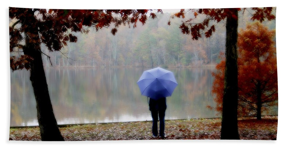 Park Hand Towel featuring the photograph Woman With A Blue Umbrella by Amy Jackson
