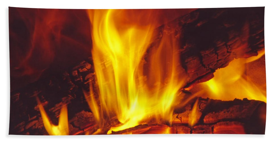 Fire Bath Towel featuring the photograph Wood Stove - Blazing Log Fire by Steve Ohlsen